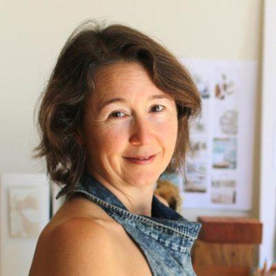 Photo of Lisa Coulburn in the design studio of natural modern interiors.