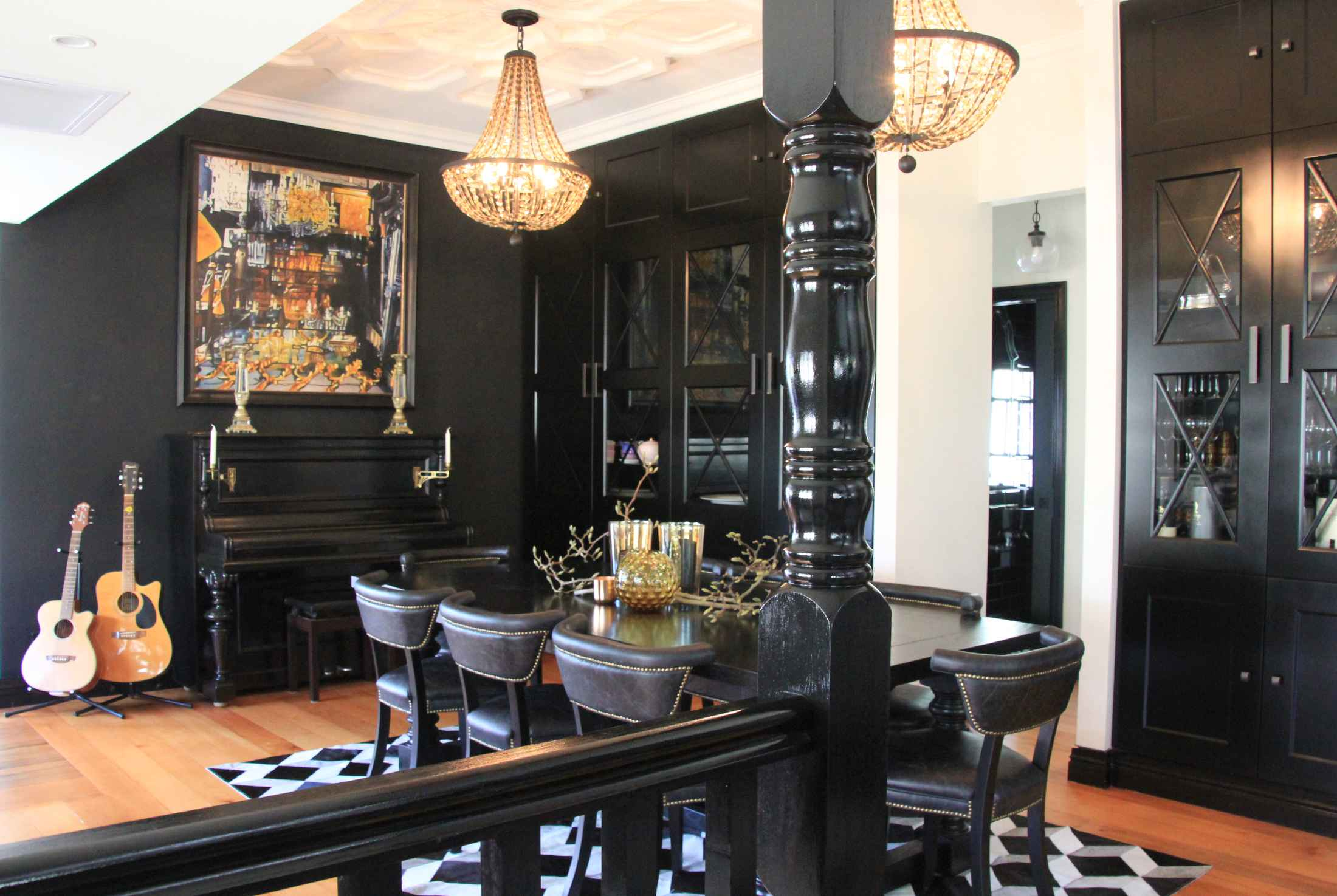 Artwork and chandeliers add focus to the dining room