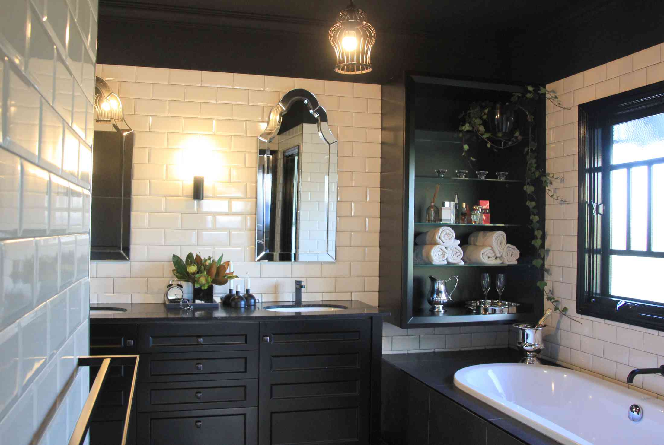 New Master en-suite bathroom with black ceiling & cabinets and subway tiles