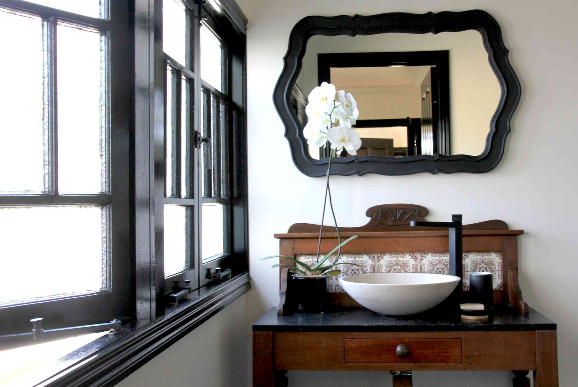 Up-cycled client's side table into bathroom vanity